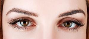 woman's eyes close-up with nude make-up and false eyelashes